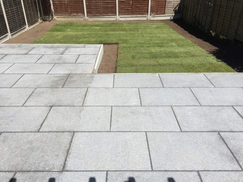 Raised patio area using contemporary granite slabs for Garden decking and slabs